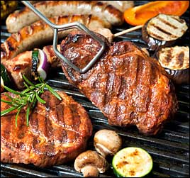 image of steaks, chicken, sausages and vegetables being cooked on a gas charbroiler